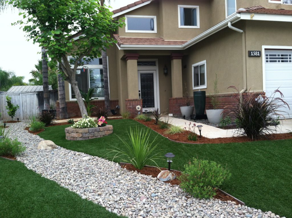 Complex front yard with multiple sections filled in between with artificial grass
