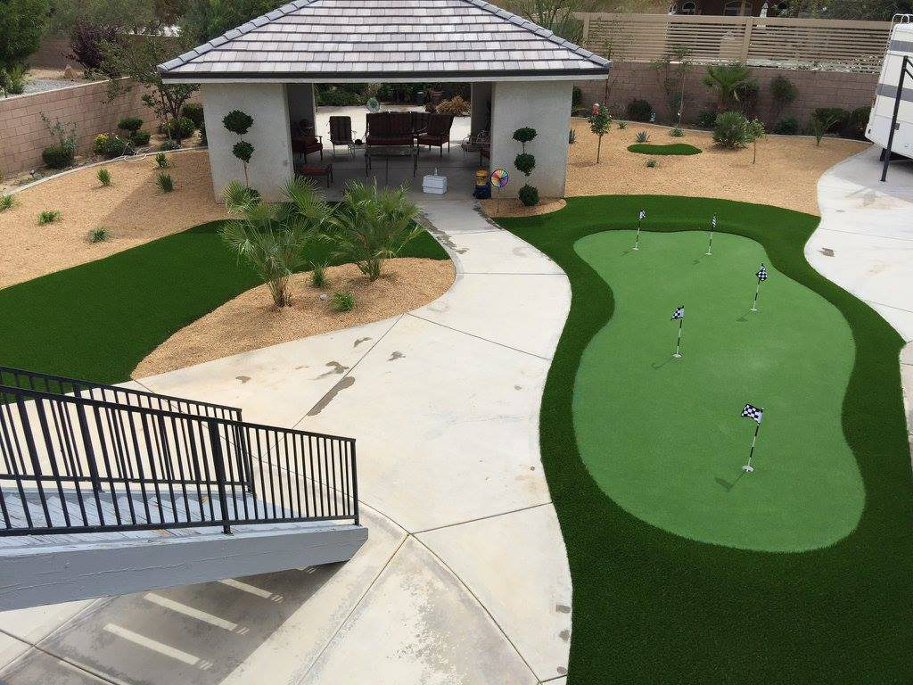Putting green made with artificial grass in a backyard