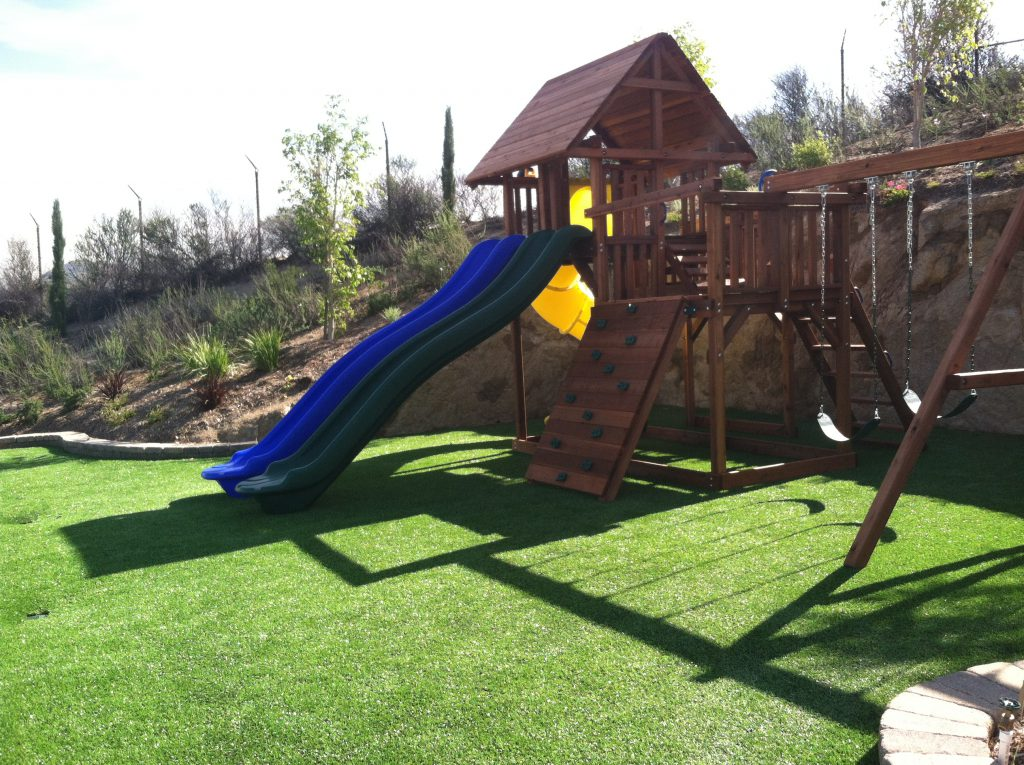 Play set on artificial grass