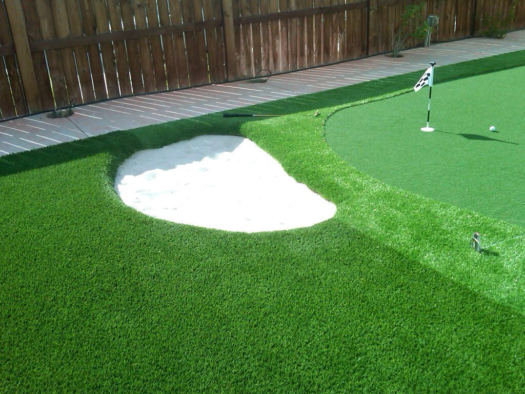 Sand trap obstacle for golfing in a field of artificial grass