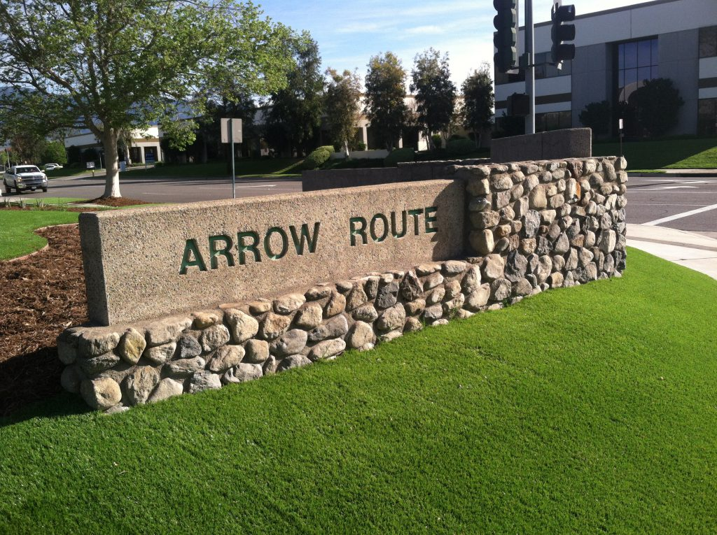 "Artificial grass surrounding a large engraved title ""Arrow Route"""