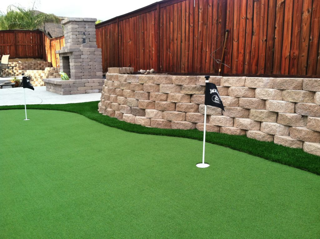 Putting green in backyard made with artificial grass