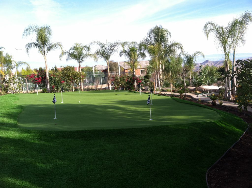 A large putting green area with artificial grass