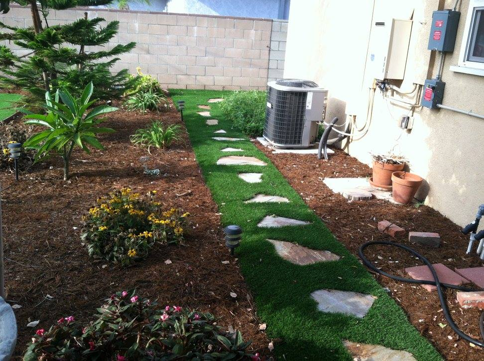 Path made of stepping stones and artificial grass