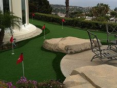 Mini putting green with artificial grass